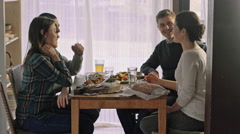 Four people having meal indoors. Rustic style room Stock Footage