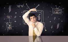Happy businessman drawing tv and radio - stock photo