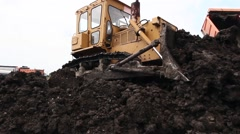 Bulldozer machine is leveling construction site. Stock Footage