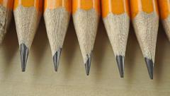Sharp nibs of numerous pencils. Macro dolly video - stock footage