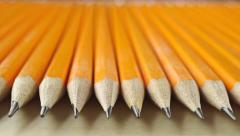 Identical sharp pencils, perspective view. Equality concept, macro dolly video Stock Footage