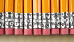 Orange pencils with pink erasers, macro dolly shot. Total censorship concept - stock footage