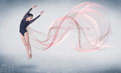Dancing ballet performance artist with abstract swirl - stock photo