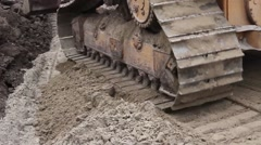 Track wheels of a heavy caterpillar construction machine. Stock Footage