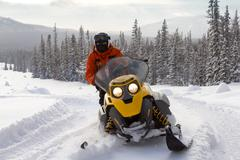 Athlete on  snowmobile - stock photo