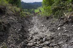 Mudslides scar the hillsides of austria following heavy rain. Europe Salzburg - stock photo
