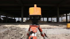 Red laser is leveling device central device to level construction site. Stock Footage