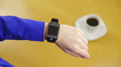 Turn on smartwatch device with coffee in background 4K Stock Footage