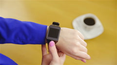 Turning-on smartwatch and browsing through apps 4K Stock Footage