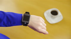 Person with pink fingernails turning off smartwatch 4K - stock footage