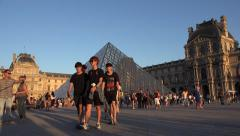 4K Tourists Walking at Louvre Museum in Paris at Sunset, Pyramid View, Traveling Stock Footage