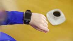 Over shoulder view person wearing smartwatch on wrist 4K Stock Footage