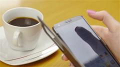 Using smartphone at coffee break closeup 4K Stock Footage