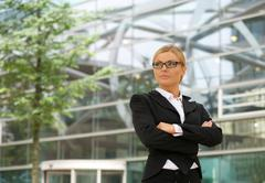 Independent business woman standing outdoors Stock Photos