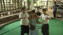 Python with spectator at Snake Show in Thailand - stock footage