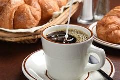 Pouring coffee creamer Stock Photos