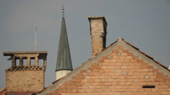 Chimneys and a conical tower's roof in Sarajevo Stock Footage