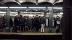 People waiting subway platform yellow line train enters West 4th St 4K NYC Stock Footage