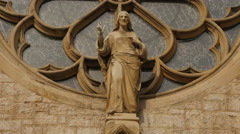 Jesus Christ statue in front the rose window of Sacred Heart Cathedral, Sarajevo Stock Footage