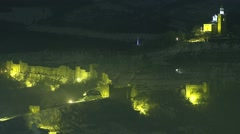 Spectacular illuminated medieval fortress Tsarevets in Bulgaria Stock Footage