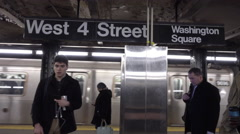 West 4th Street Washington Square subway station sign train leaving platform 4K Stock Footage
