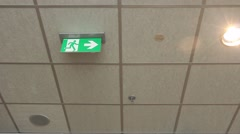 Green emergency exit sign. Stock Footage
