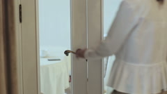 Girl opens beautiful classic door, enters the room Stock Footage