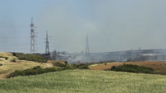 Fire and smoke on a hill where vegetation burn  - stock footage