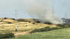 Fire and smoke on a hill where vegetation burn  Stock Footage