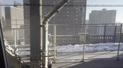 Graffiti and Brooklyn housing projects from moving B subway train in NYC Stock Footage