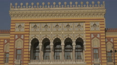 The facade with arches and balcony of Sarajevo Library Stock Footage