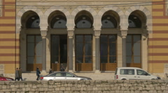 Walking and driving in front of Sarajevo Library Stock Footage