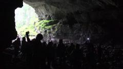 4K Tourists using Flashlight while Exploring the Coiba Mare Cave Stock Footage