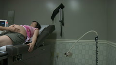 Pregnant Woman Getting Pregnancy Exam Stock Footage