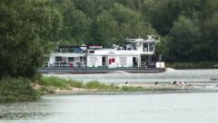 Passenger boat out on a secondary channel on the main thread of the river - stock footage