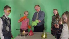Students in primary school and the teacher making chemical experiments. - stock footage
