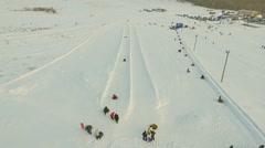 Flight above tne snow tubing track. Stock Footage