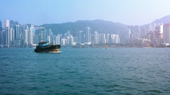 Tug boats and passenger ferry in Hong Kong's harbor. Video 4k Stock Footage