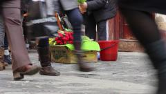 Saleswoman of tulips, on the street, at a country fair. Many people pass by  Stock Footage
