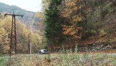Rally place on a mountain road. A car passing on the road. Rally takes place 1 Stock Footage