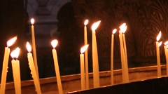The candles flame in church of the Holy Sepulchre in Jerusalem Stock Footage