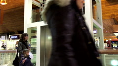 One side of people taking elevator in Coquitlam shopping mall Stock Footage