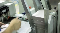 Automatic machine printing books, offset and photo printed products. - stock footage