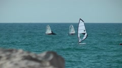 A sailboat on the horizon in the beautiful Mediterrian sea in Tel Aviv - stock footage