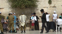 Prayers at The Western Wall in Jerusalem, Israel - stock footage