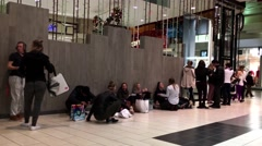 People line up for boxing day sale in Coquitlam shopping mall Stock Footage