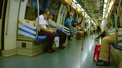 Passengers boarding and riding the subway in downtown Singapore. Video 4k Stock Footage