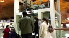 One side of people taking elevator in Coquitlam shopping mall - stock footage