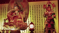 Religious sculptures inside the Buddha Tooth Relic Temple. Video 4k Stock Footage