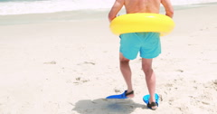 Senior man going in the sea Stock Footage